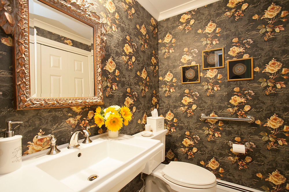 Powder room patterened wallpaper console sink traditional