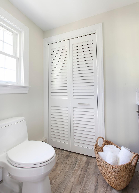 Bathroom design porcelain floors white walls