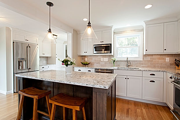 White painted cabinets and dark stained island.  Kitchen designed and installed by Kitchen & Bath Design + Construction.