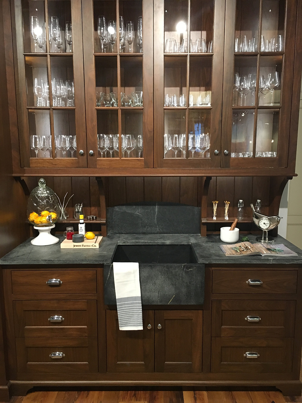 Warm wood cabinetry with soapstone sink and countertop.