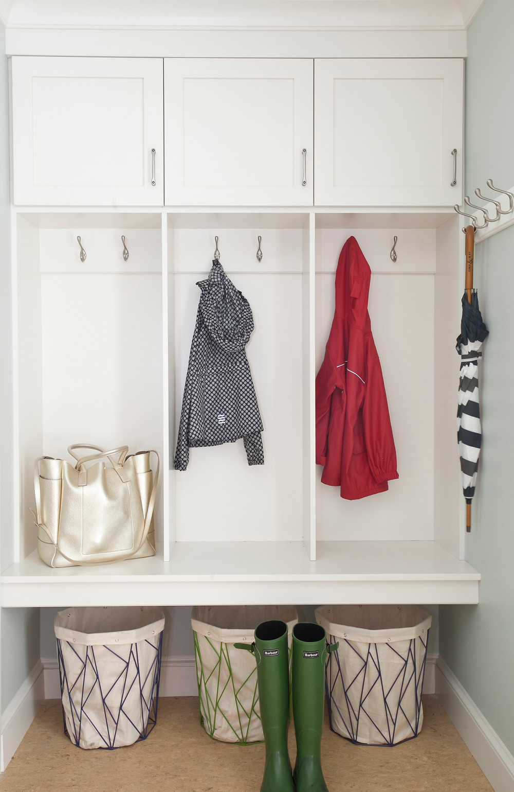 Mudroom with built-in cubbies and hooks
