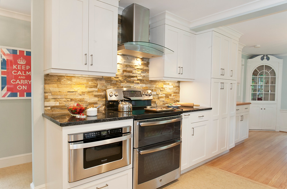 White kitchen design granite countertops stainless appliances built in microwave