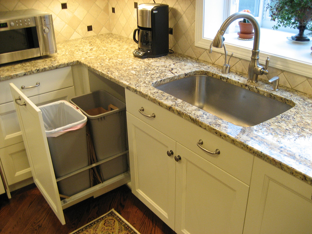 White kitchen with recycling and trash pullout