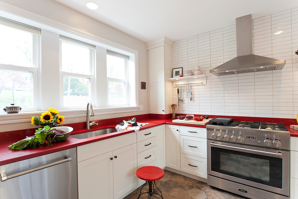 Red quartz countertops in white kitchen