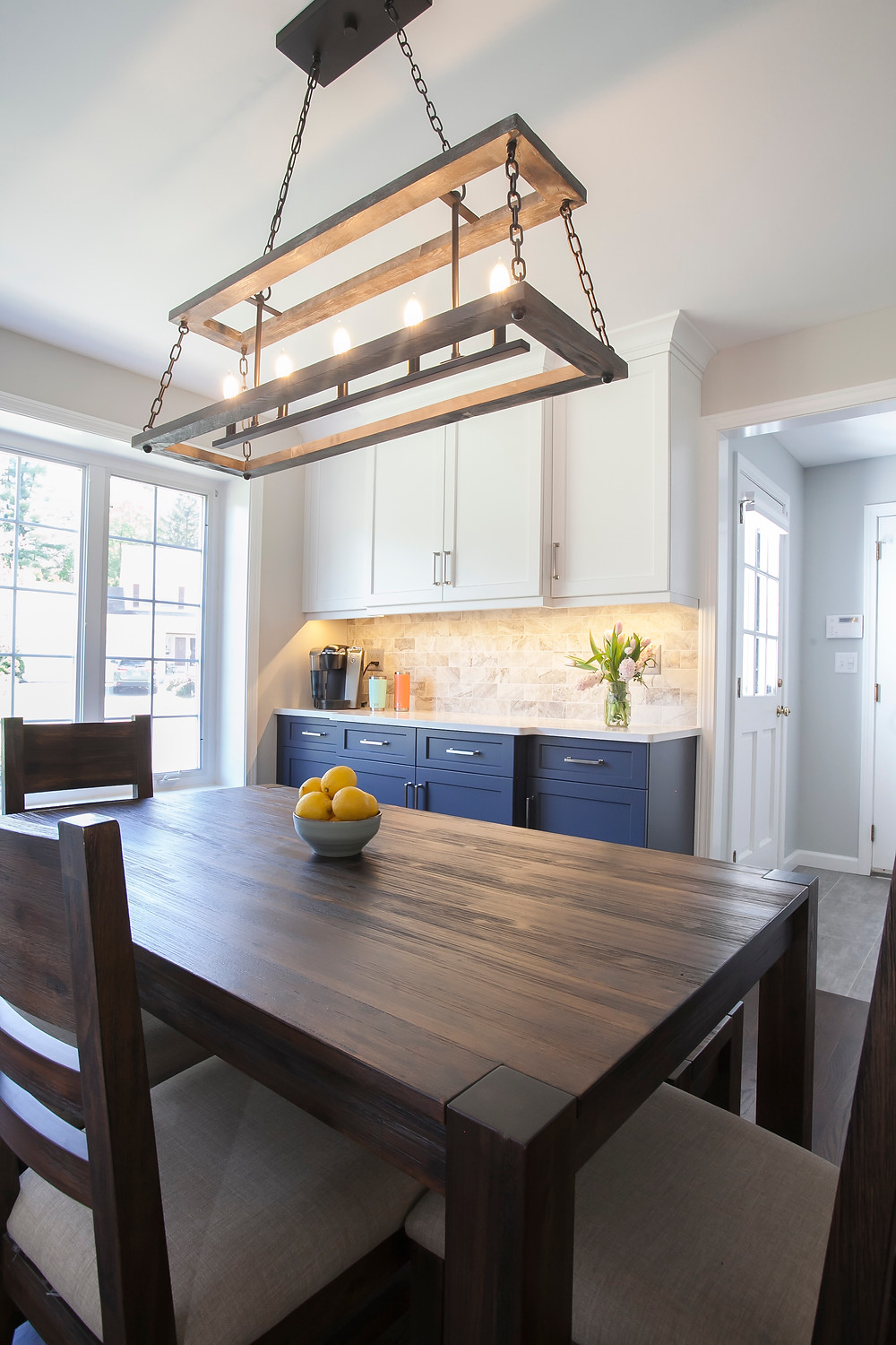 Dining room with contemporary rustic light fixture