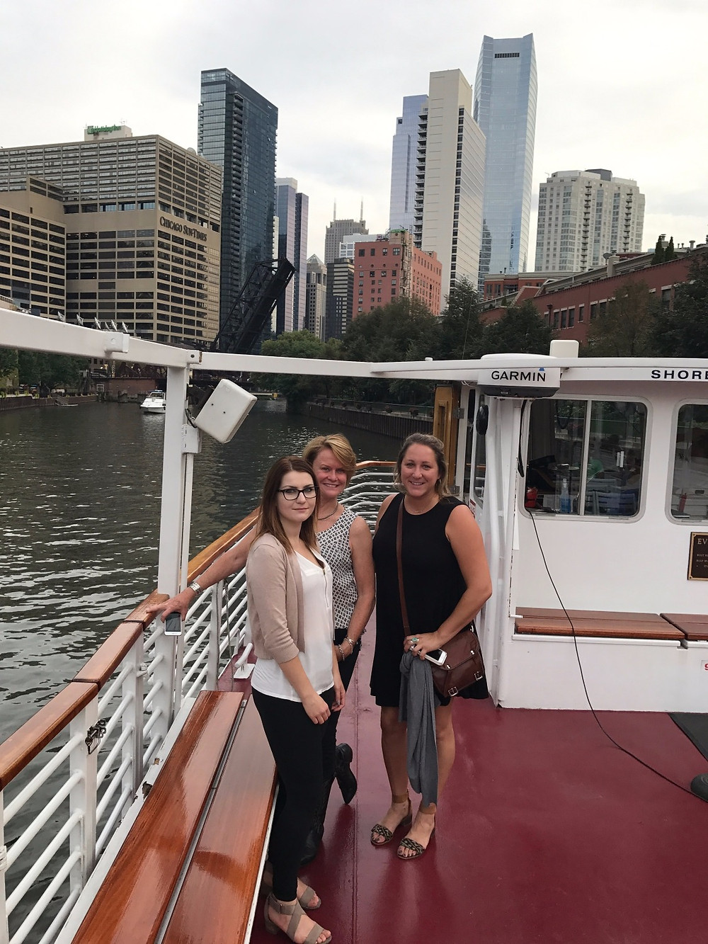 KBDC Owner Lorey Cavanaugh with Design Associate, Kate and Design Assistant, Paulina on an architectural boat tour along the Chicago River.
