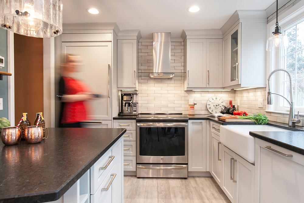 Small, grey kitchen designed by Kate Yurgelun