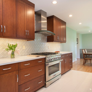 Stained Cherry Cabinets and Glass Backsplash