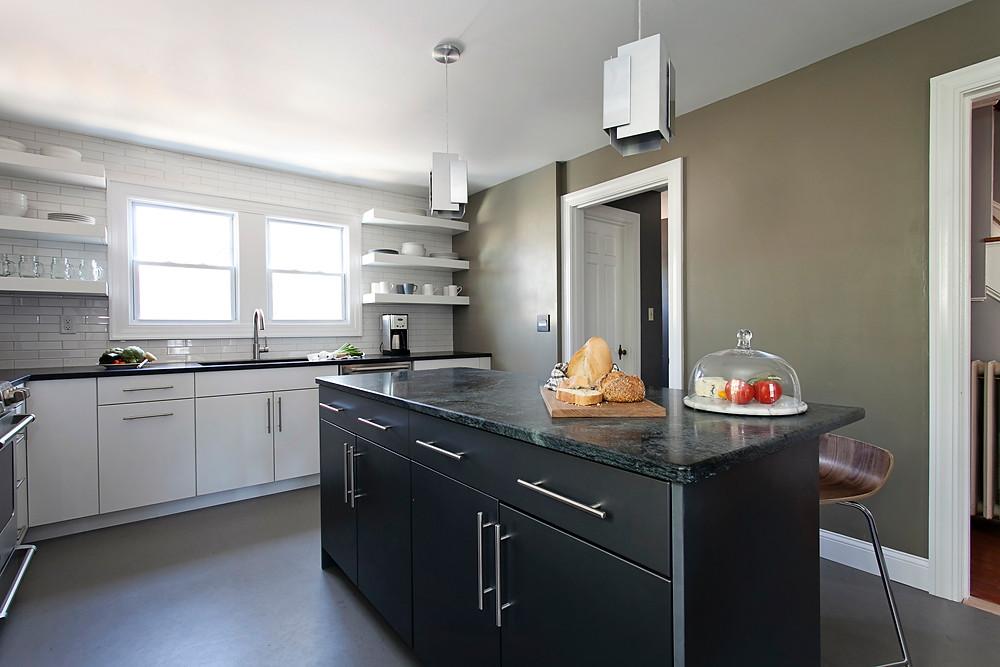 Dark, dramatic color palette in kitchen