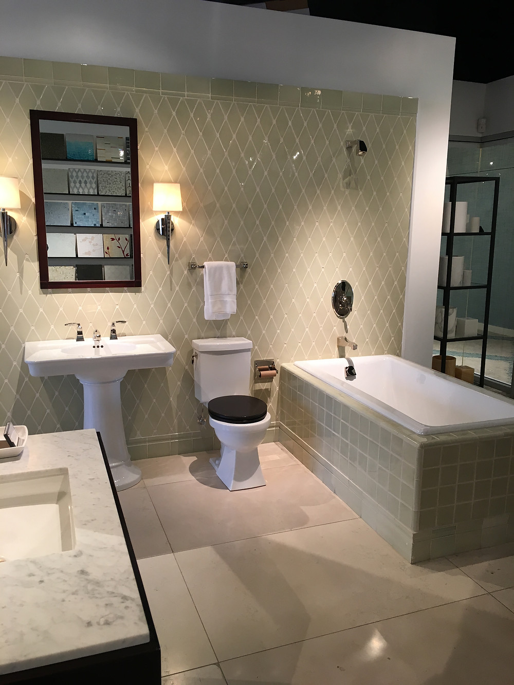 The extra large floor tiles help add drama to this bath vignette.