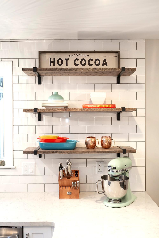 Wood open shelves with subway tile backsplash