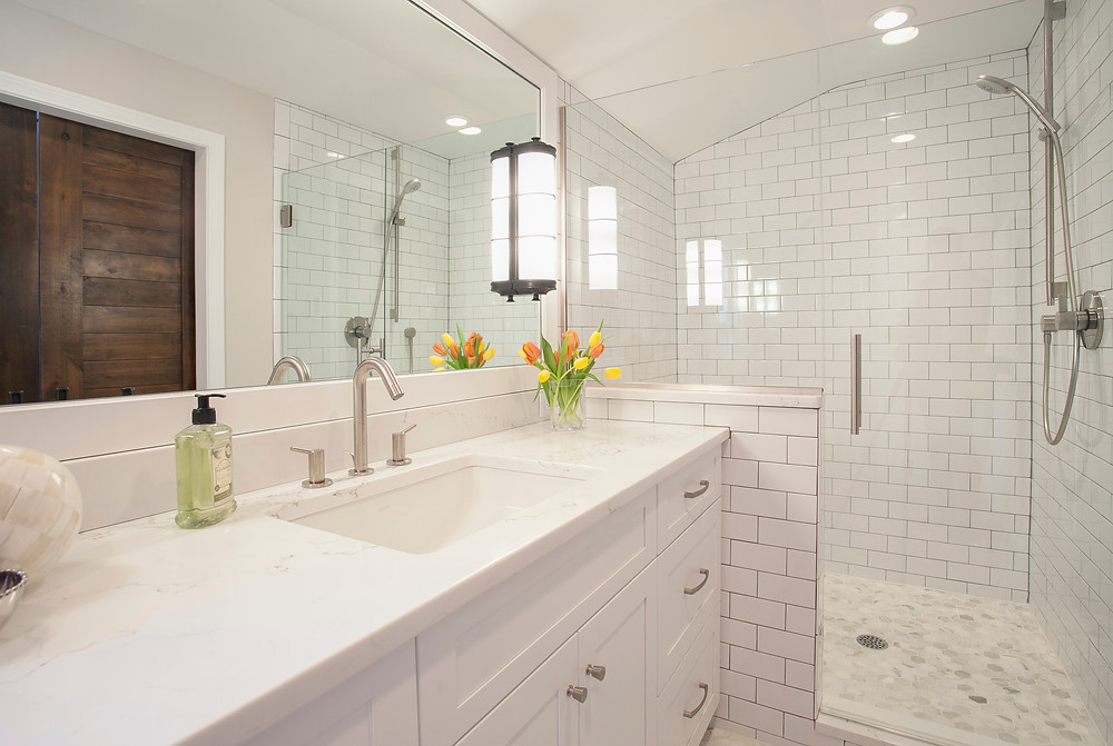 White bathroom with white countertops and cabinets