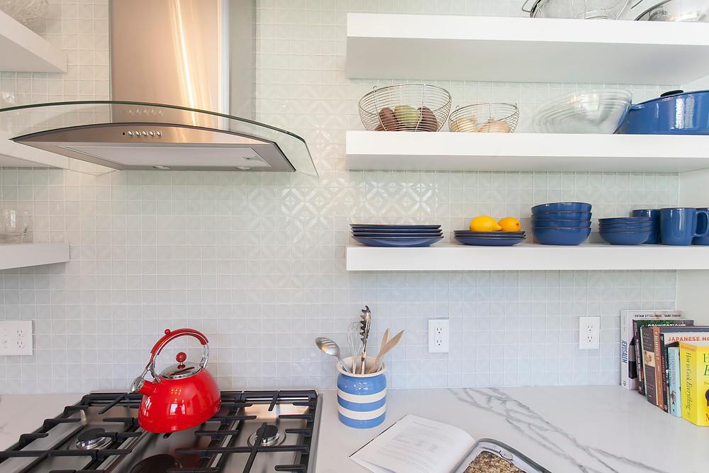 White kitchen with mosaic backsplash