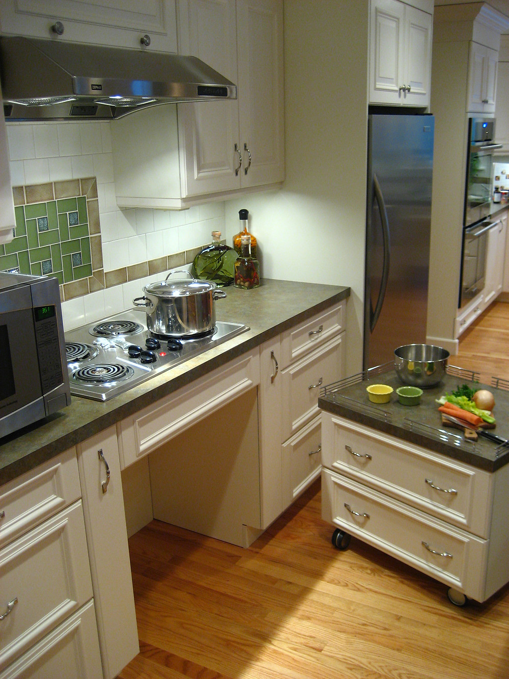 Movable base cabinetry handicap accessible cooktop range