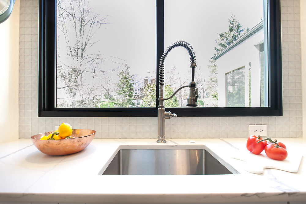 Industrial style faucet with visible spring