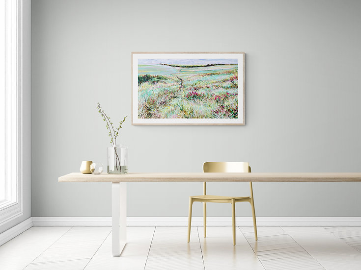 A JLMohr fine art print hangs on the wall of a minimalist dining room.