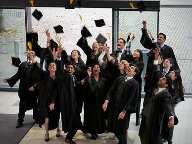 happy-graduates-mba-bachelor-or-master-degree-celebrating-graduation-by-throwing-up-their-