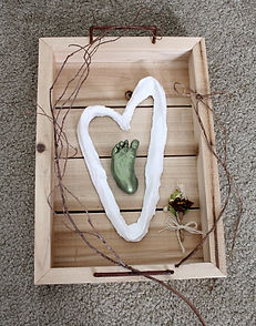 newborn green foot in shadowbox.jpg