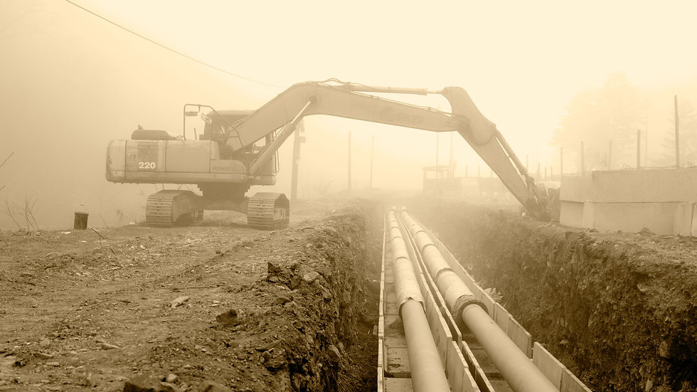 excavator%20beside%20large%20pipes_edite