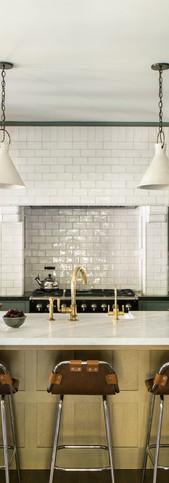 Craftsman kitchen with vintage tile range hood