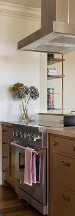 peninsula kitchen, island range hood, painted lower cabinets