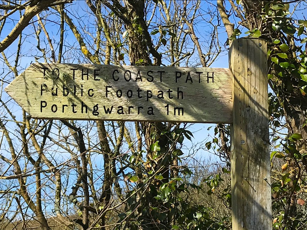 Circular-Walk from Porthcurno Beach Cafe, Porthcurno, Cornwall, UK. Signpost to Coast Path