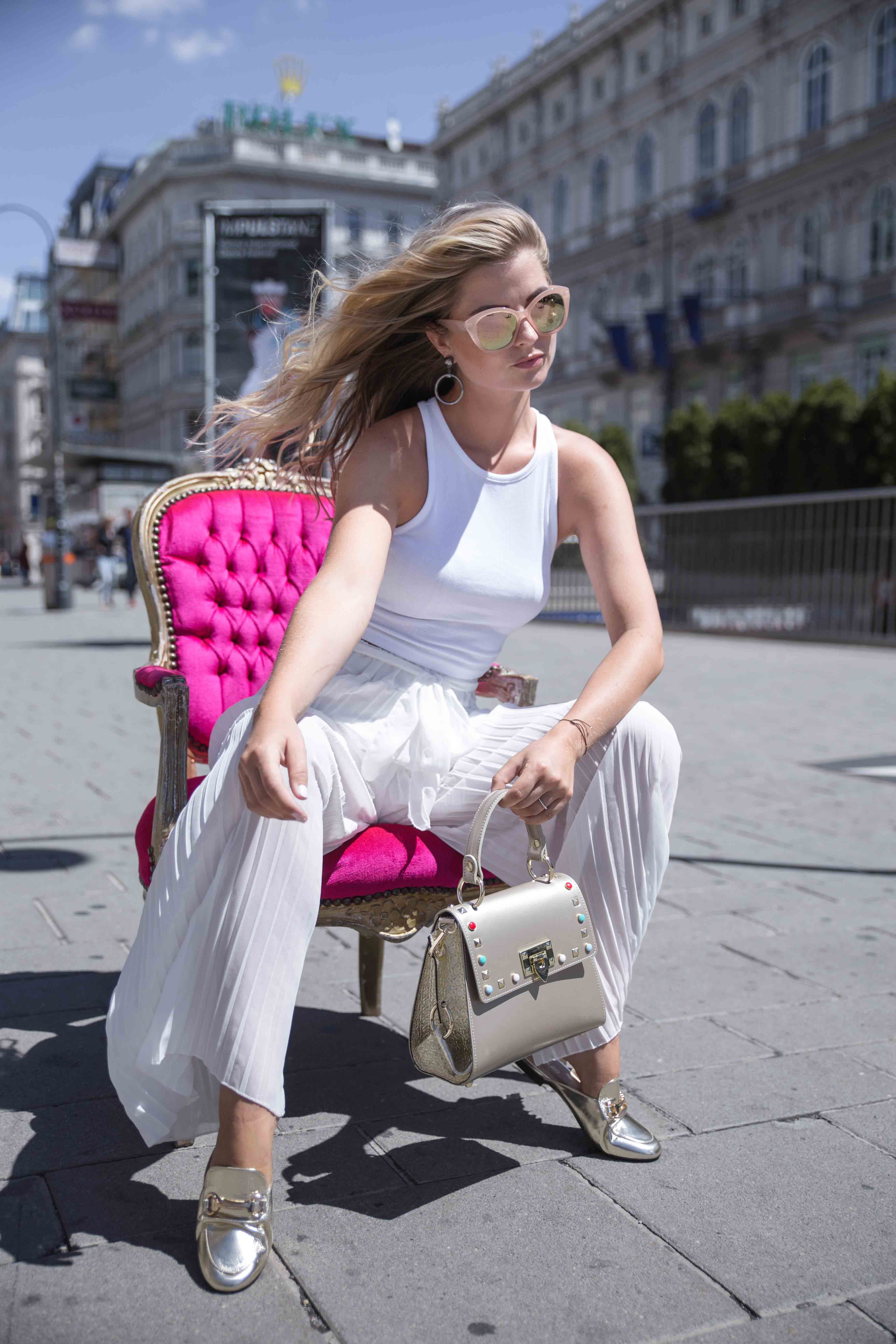Model sitting on chair in Vienna