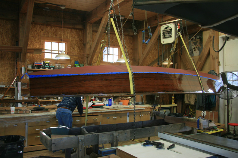 Flipping boat over to start deck installation.