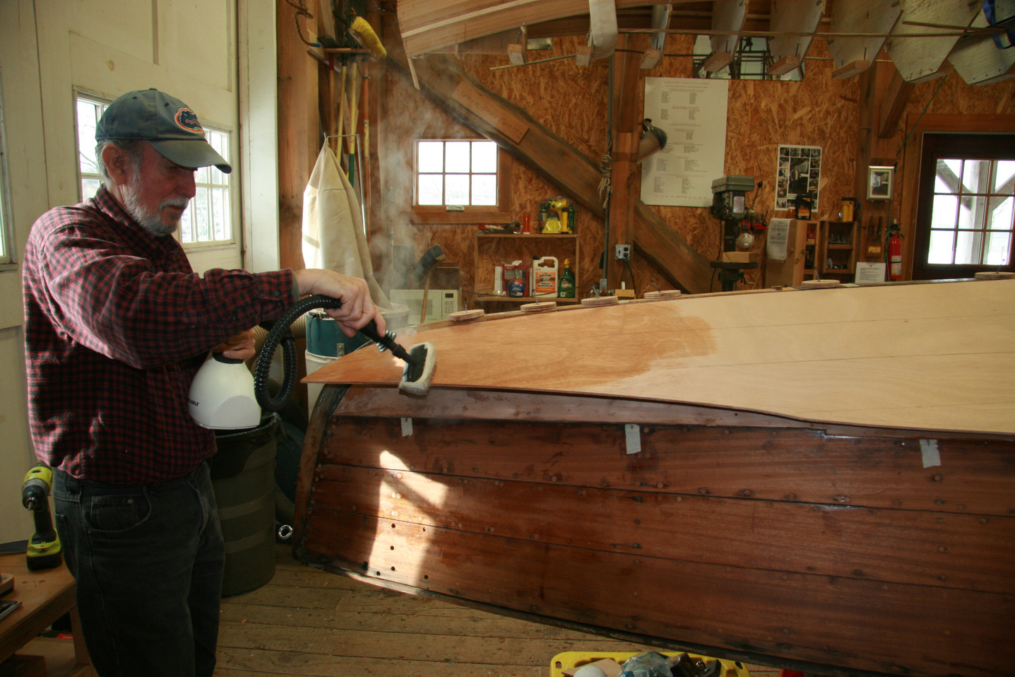 Steaming plywood sheathing to ease bending