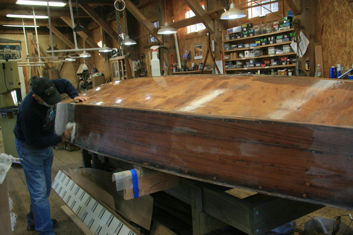 Hull fiberglassing complete. prepping for bottom paint.