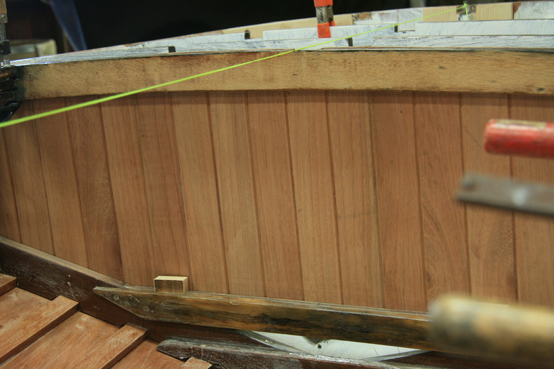 Mahogany paneled lazerette before cutting the opening