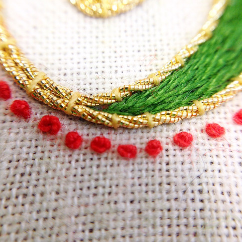 Close up celtic embroidery french knots