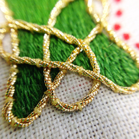 Close up celtic embroidery