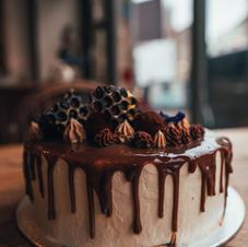 Vegan chocolate and salted caramel drip cake