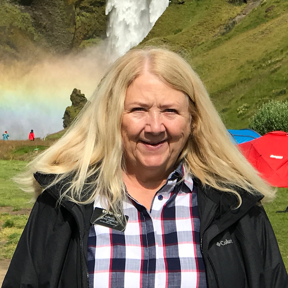 Susan Huff in front of waterfall in Iceland