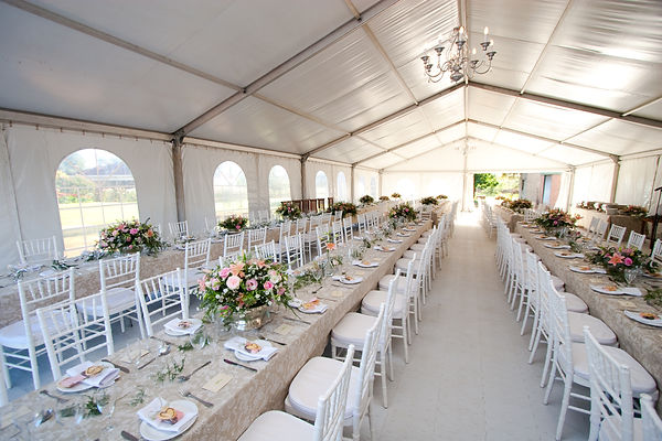 The inside of a massive white wedding te