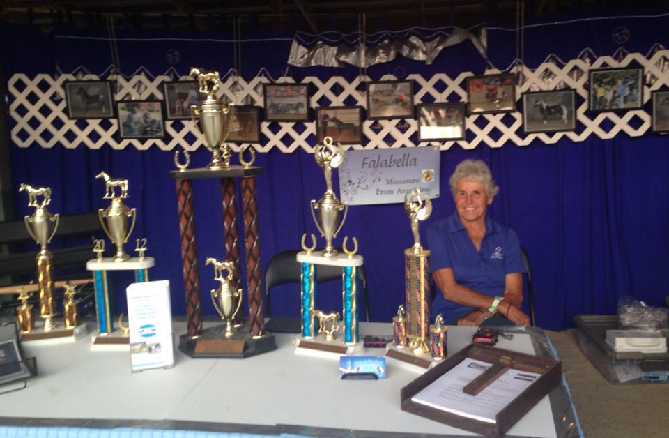 Carol and trophies.jpg