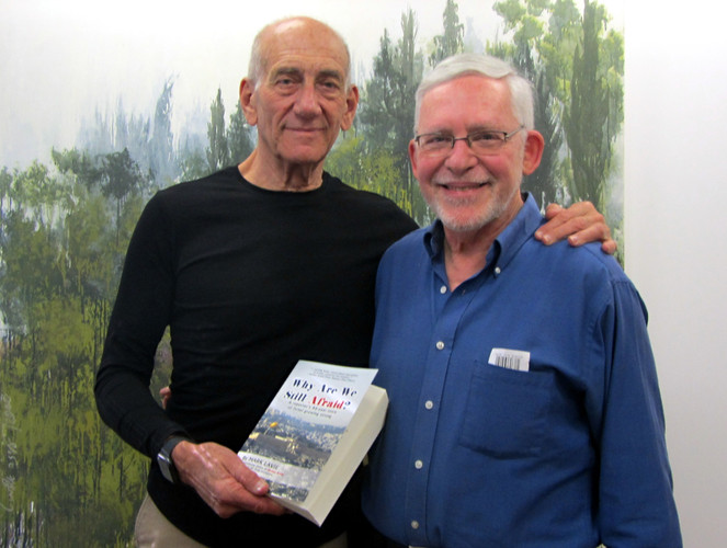 Former Israeli Prime Minister Ehud Olmert with his sgned book
