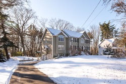 Beige house photographed by The Priestley's Fine Art Photography in Lynnfield, MA