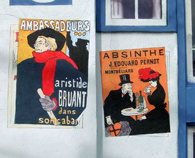 Tromp l'oeil posters on a stucco wall