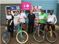 Supported Volunteers build bikes assisted by Lead Volunteers under the leadership of Levon Pegg