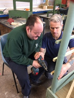 Our volunteer Mark is instructing Danny on the correct use of a cordless drill