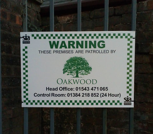 Oakwood Security Solutions sign for vacant property inspections