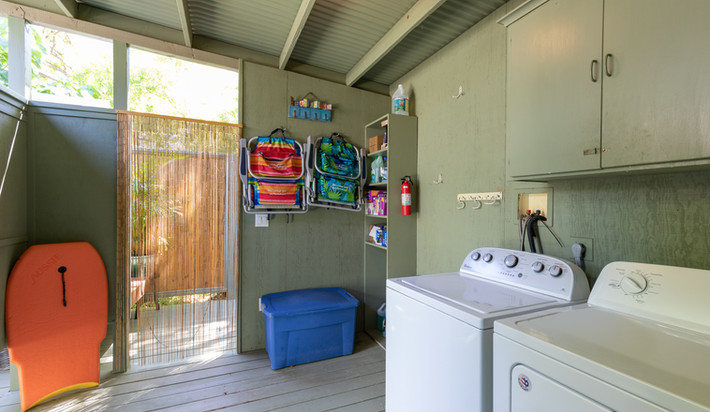 Laundry area, beach gear storage and entry to outdoor shower