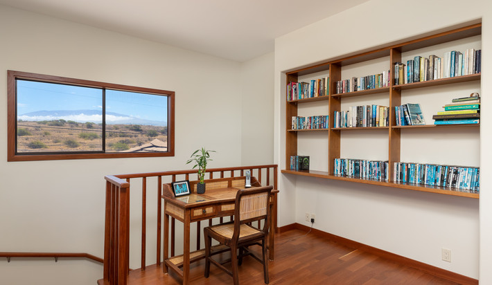 Upstairs desk and library area