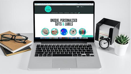 Lou's Labels Website Design Mock Up on Laptop by Bee More Design