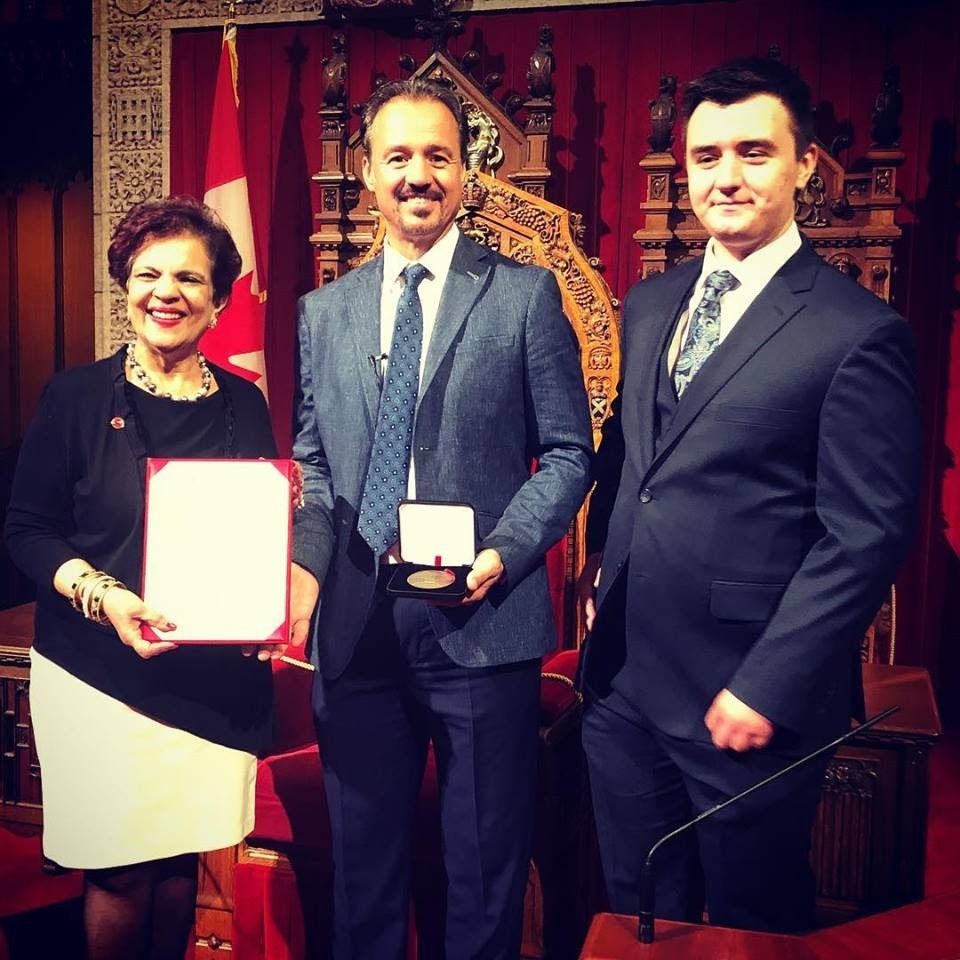 Eric Edmeades was awarded a medal from the Canadian Senate for his work in improving the quality of people's lives