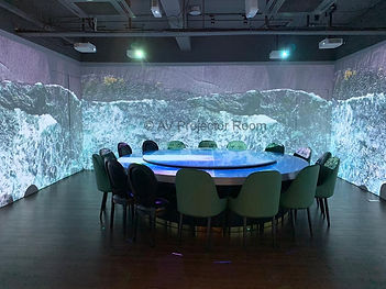 Immersive dining experience using projection curve edge blending and table cropping by AV Projector room Malaysia