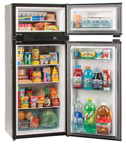 Refrigerator stocked with food for scale