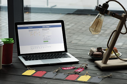 laptop-with-facebook-website-on-table-with-macaron-SRGRQEH.jpg
